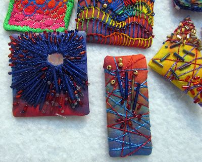 Fibermania - fiber art pins - several more on the site - gorgeous textile mini tapestries