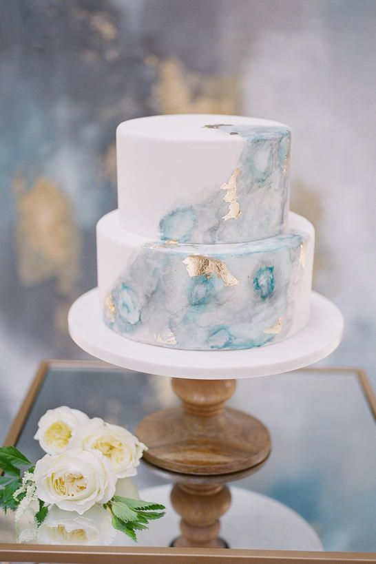 A Subtle Statement - Watercolor Wedding Cakes Might Be the Next Big Wedding Trend - Southernliving. Something blue meets a simple cake canvas, gold flakes, and watercolor jewel tones to create a true wedding gem.  Click here to see the pin.