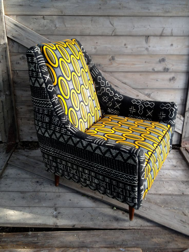 Danish mid-century chair in African attire. $1,200.00, via Etsy.