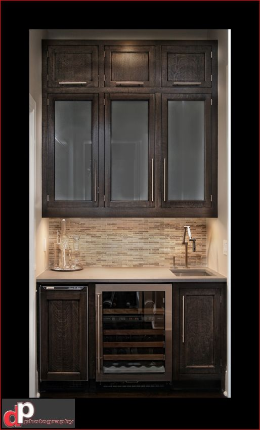 Coffe Bar with sink and refrigerator/ice maker  Cabinets to match those in the bath area.  Oil rubbed bronze bar type sink fixture  Granite counter and tile backsplash on a diagonal pattern