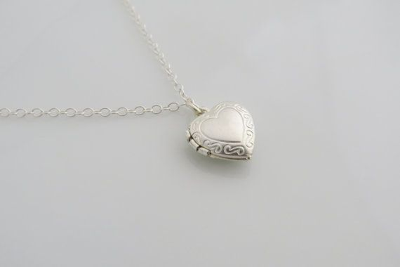 This tiny silver necklace is so cute. Little silver heart locket on a dainty 16 inches sterling silver necklace. A simple small heart necklace you