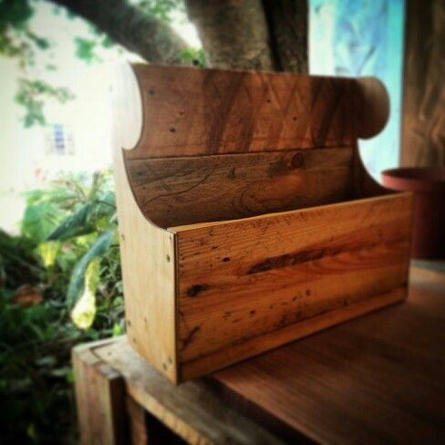 Magazine holder made from pallets and recycled ply.