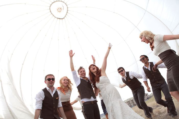 How awesome to incorporate a white parachute into wedding photos...must find a parachute!!
