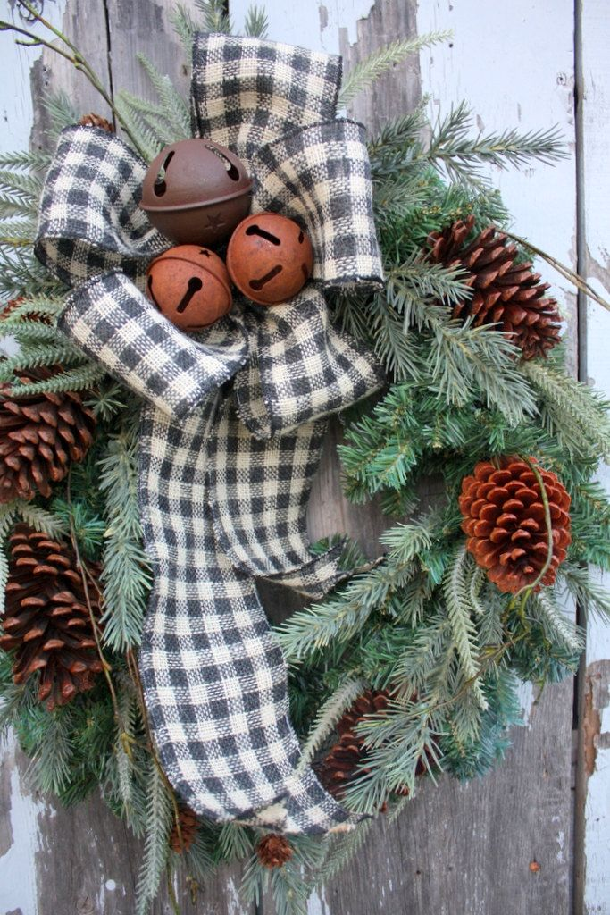 checked burlap, greenery, bells, and pine cones