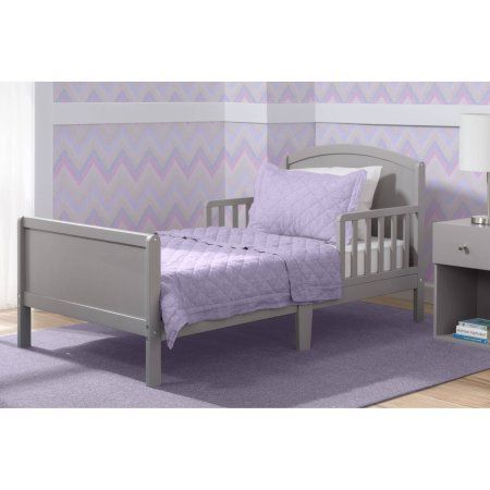 Update your toddler's bedroom with the Archer Toddler Bed from #Delta Children. Crafted from strong and sturdy wood, this versatile toddler bed features a gracef...