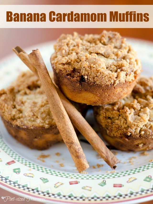 """Bananas and cardamom spice make these muffins scream, """"Happy Fall Ya'll!"""" Topped with a streusel topping, these muffins are perfect for a buys fall morning breakfast. Enjoy!"""