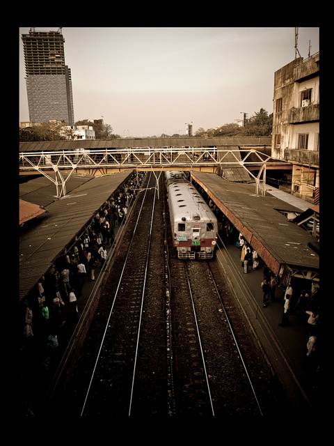mumbai train pulling into a station