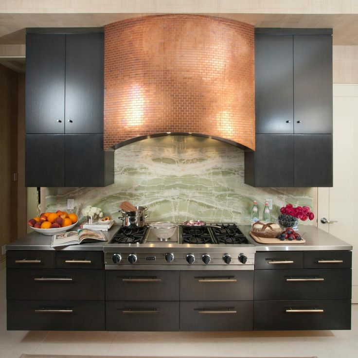 21 Sleek And Modern Metal Kitchen Designs: A Gorgeous Copper Tile Range Hood Stands Out Against Sleek