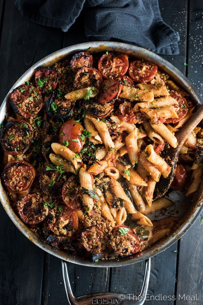 One Pot Vegan Pasta is the ultimate easy and delicious dinner recipe. The pasta is cooked in a spicy sun-dried tomato and roasted red pepper sauce then covered in tomatoes and buttered breadcrumbs and broiled to perfection. | theendlessmeal.com