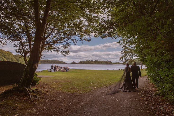 The bride wore a black wedding dress at Ashford Castle lawn ceremony