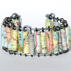 "Map bracelet... but this would be cool with an old dictionary... and have the words be things like ""Joy, Peace, Love, Friends..."""