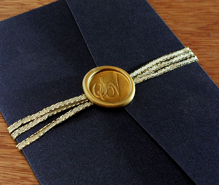 Our custom wax seals are adhesive, so affixing them to your invitations and enclosures is easy and stress-free. | Invitations by Ajalon | http://www.invitationsbyajalon.com/