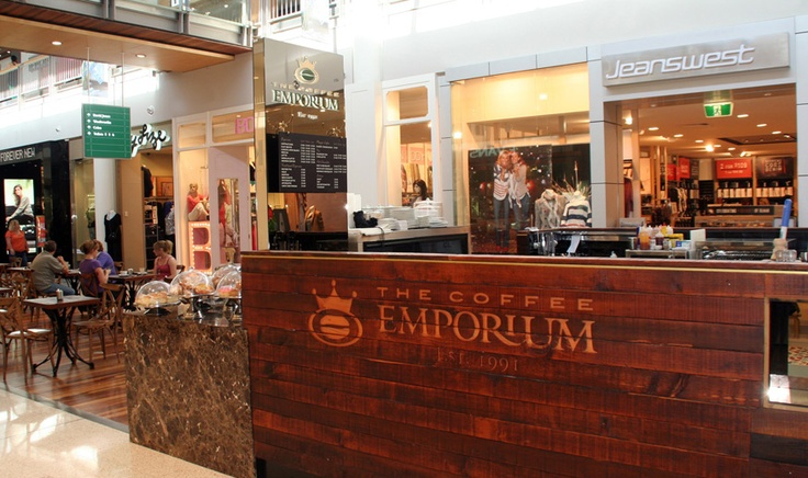 Complete Corporate Signage Solution for The Coffee Emporium, kiosk signage, menu boards, Bronze mirror blade signs, routed timber counter frontage by Singleton Moore Signs www.smsco.com.au