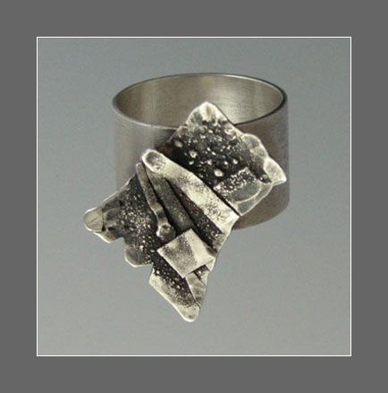 Heat textured and fused layers of sterling silver. By Connie Fox.