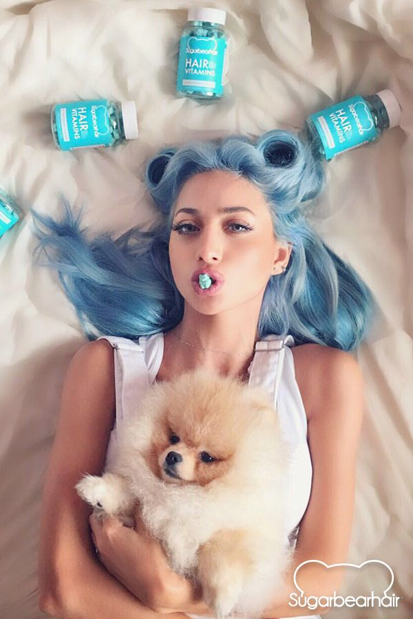 Model Roz enjoys 2 SugarBearHair gummy vitamins each day for healthier hair.