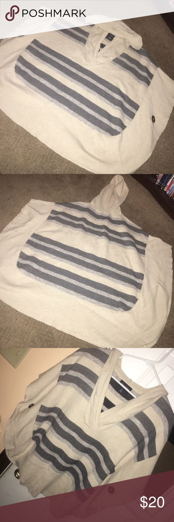 American eagle poncho 🌻 Good used condition. No flaws. Poncho style. Open sides. Buttons keep the arm holes in place. This was always my flight outfit 😂 since it was comfy and trendy for early mornings to the airport. Oatmeal color. Blue & gray stripes. Size xs/small. Runs big. American Eagle Outfitters Tops