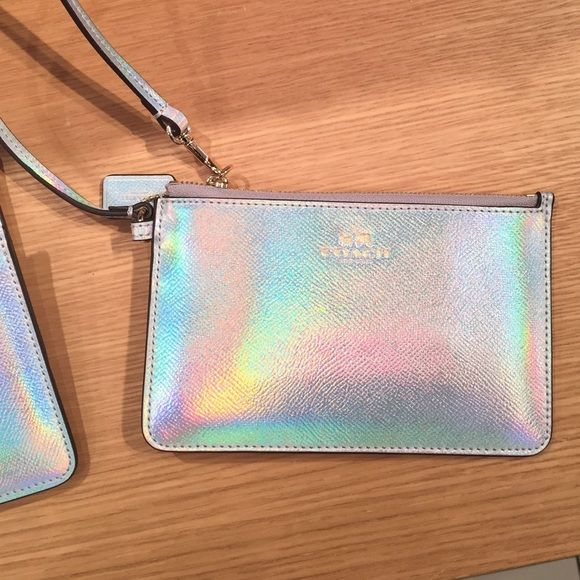 FINAL PRICE! Coach hologram wristlet Coach silver hologram wristlet, straight from the store & perfect condition. Has interior card pockets & zip closure. Bundle it with the cosmetic case & large Tote in my closet! NWT Coach Bags Clutches & Wristlets