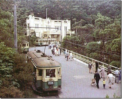 The lower entrance to Taronga Park Zoo, some people walking up the road after arriving by ferry from Circular Quay in Sydney in the 1950's . v@e.