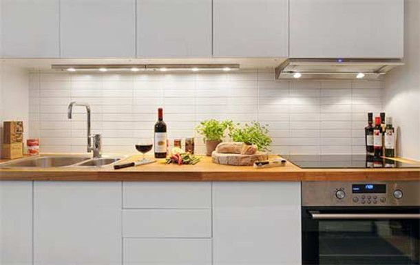 Small Apartment Kitchen Decorating In White With Wooden Countertop Ideas - pictures, photos, images