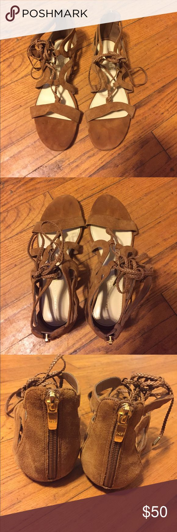 Marc Fisher Lace-Up Suede Sandals Excellent Condition Marc Fisher Braided Leather Lace-up Suede Sandals. Only signs of wear on soles per pictures. Size 7. Zip up back for ease. Marc Fisher Shoes Sandals