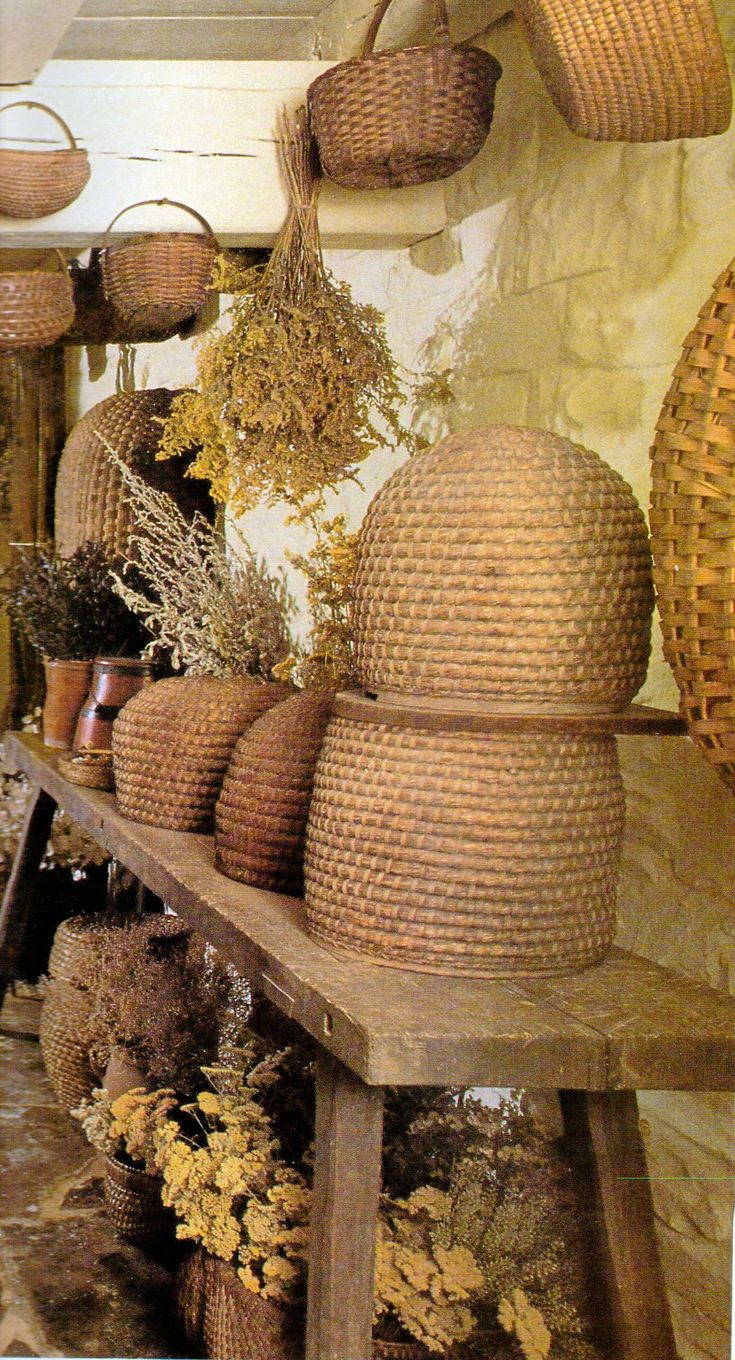 Baskets, bee skeps, and drying herbs.