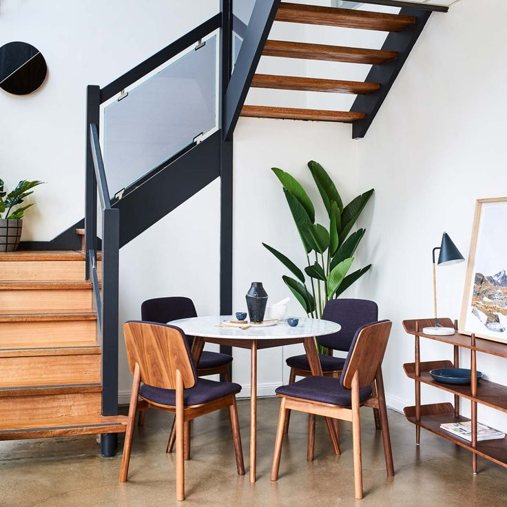 Got some extra under stair space? Our compact dining set here will brighten it up with some marble accent and greenery.