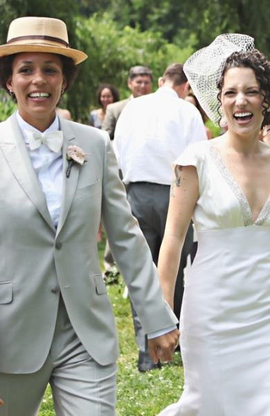 Lesbian wedding: white gown, dapper suit & bow tie, adorable couple. #interraciallesbians #qwocwedding