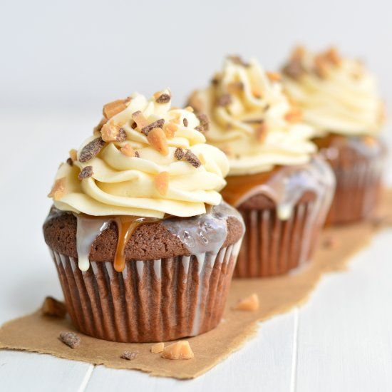 Moist devil's food cake covered in sweetened condensed milk, butterscotch caramel, and topped with fluffy frosting and Heath bits.