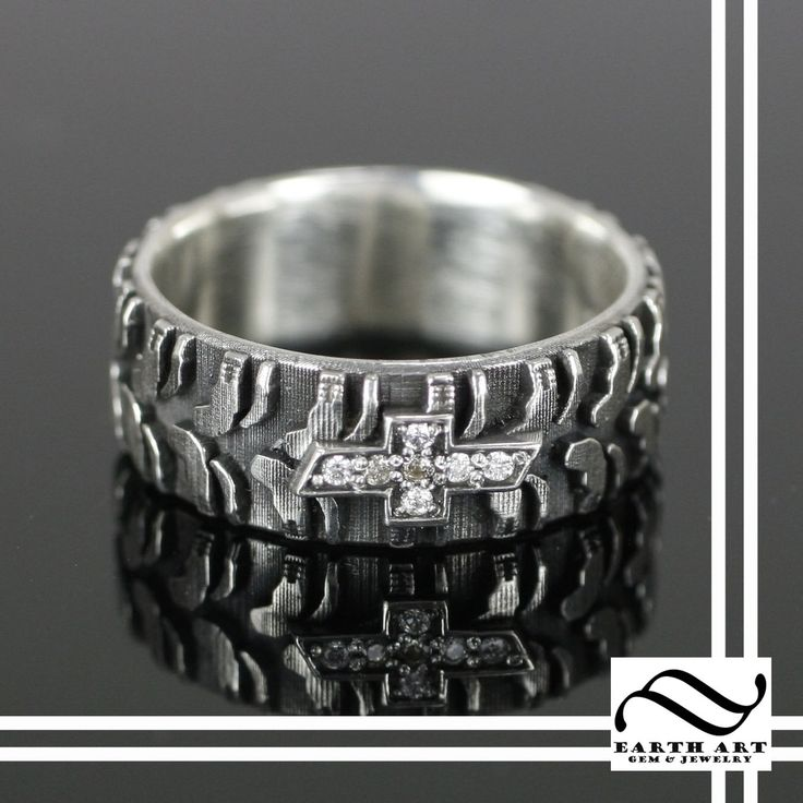 CustomMade by Austin Moore: Made from sterling silver.  This ring features a nicely detailed tire tread pattern which continues around the full ring.  On the top, the Chevrolet