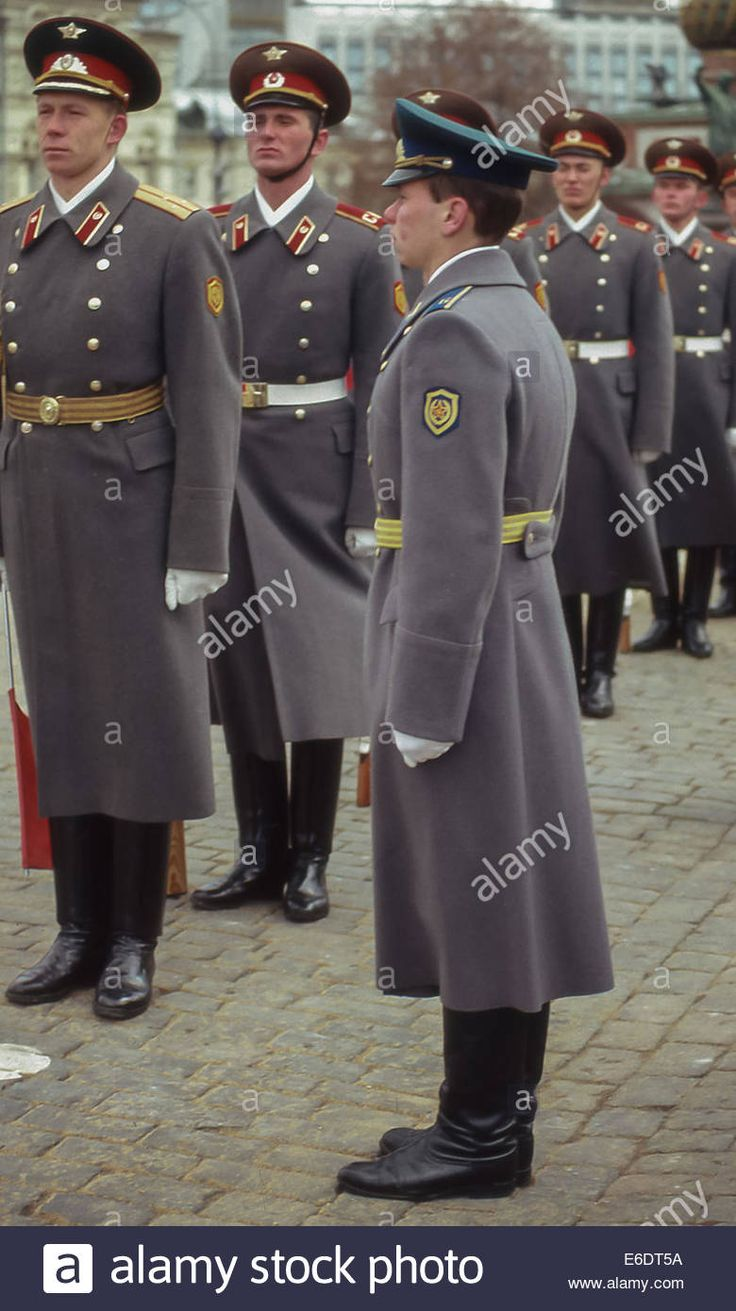 Joseph Finder The Moscow Club Moscow, Russia. 7th Nov, 1987. Soviet Army honor guards, in dress uniform (red epaulets), stand at attention before moving to their posts. In foreground is a uniformed KGB security guard (green topped cap) at his post. They were among the more than 150,000 soldiers, sailors and civilians who marched through Red Square in the massive parade celebrating the 70th anniversary of the Bolshevik Revolution of 1917. © Arnold Drapkin/ZUMA Wire/Alamy Live News Stock Photo