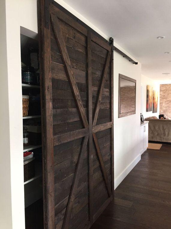 Dark stained rustic sliding barn door by for Barn loft doors