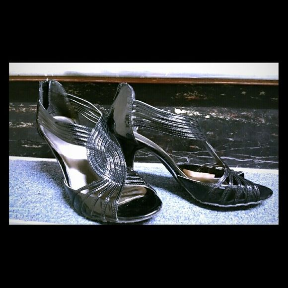 """ELLE shoes Sassy...modern...and stylish black shoes.  Heel is 4"""" high. Elle Shoes"""