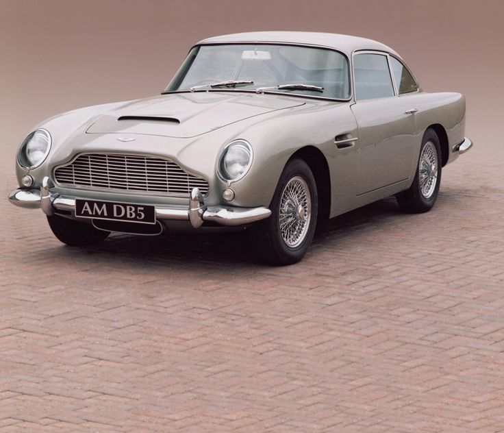 """Aston Martin DB5: Often billed as the """"most famous car in the world"""", James Bond's gadget laden Silver Birch DB5 in Goldfinger became many a schoolboy's dream. Regarded by many as the most beautiful Aston Martin produced, the DB5 shares many similar traits to the DB4. However, DB5's most substantial change occurred under the bonnet.    The engine capacity was enlarged to 4 litres by increasing the bore to 96mm."""
