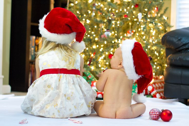 Christmas photo prop with a baby and sibling