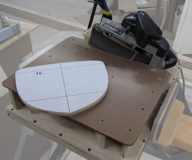 This Instructable will show you how I built a bench-top edge-sanding jig to hold my hand-held belt sander on its side and allow me to precisely and carefully sand the edges of workpieces. I built this because I do not have a permanent workspace to house a dedicated stationary tool (and those are expensive). Also, I already had a handheld belt sander, and quite a few belts for it. This Instructable is broken down into the following steps: Step 1: Goals, materials, & tools Step 2: Build a s...