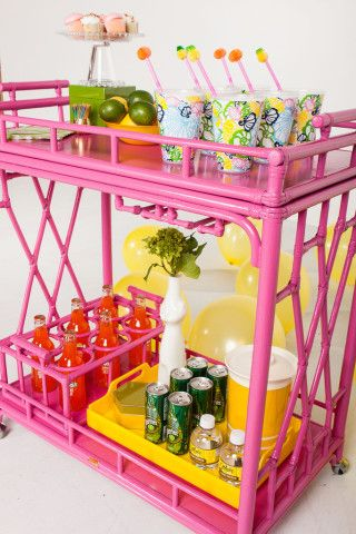 We have a fabulous multi-tiered rolling bar cart in the shop larger than this one.  YOU could make it pink with our CeCe Caldwell chalk and clay paint!  The Worth Rattan Bar Cart