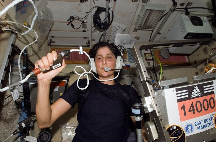 ISS-14 Williams Marathon - Sunita Williams- running the 2007 Marathon in Space Station (1st to do). Astronaut Sunita Williams, Expedition 14 flight engineer, circled Earth almost three times as she participated in the Boston Marathon from space. She is seen here with her feet off the station treadmill on which she ultimately ran about six miles per hour while flying more than five miles each second.