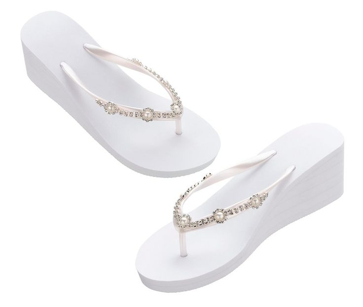 These wedge flip flops give the bride a boost of style and comfort while getting ready for the ceremony or dancing at the reception. They are accented with pearls and rhinestones and make a great gift