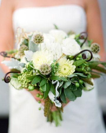 Fresh millet, bay laurel, and succulents create a lush bouquet.