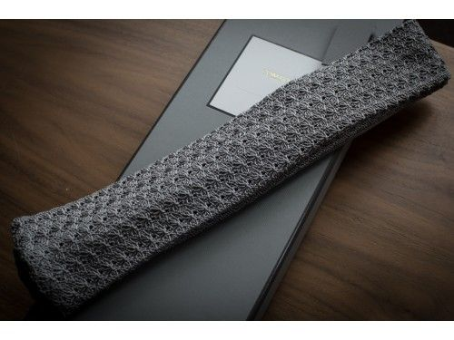 Tom Ford spider patterned gray knit tie. Sick.