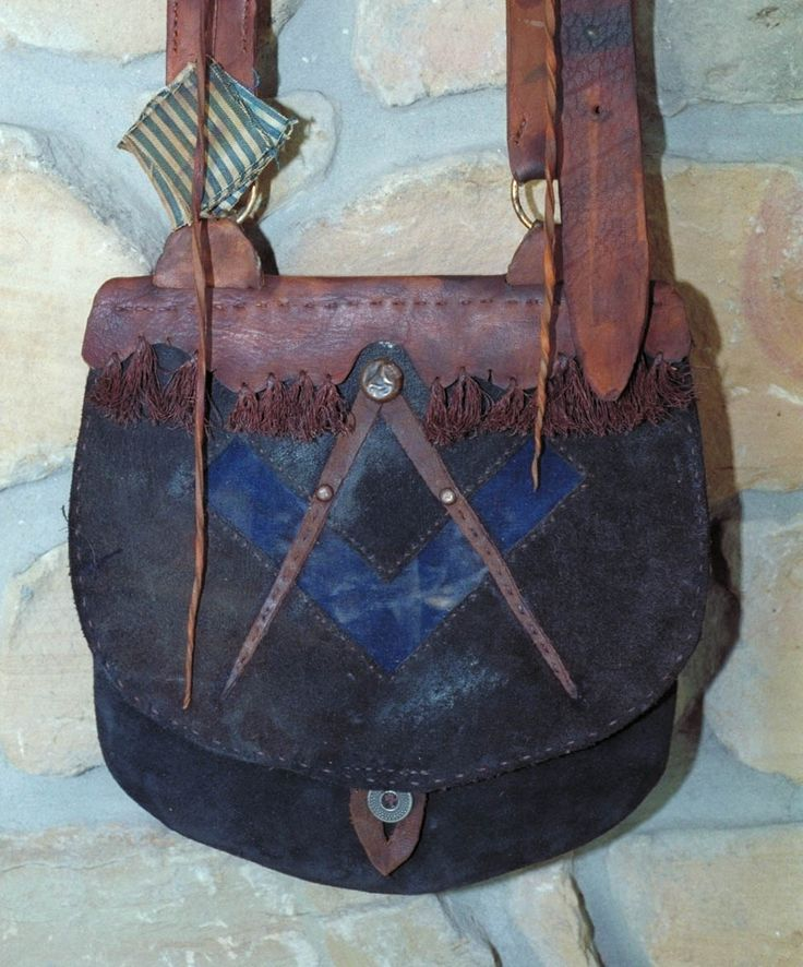 Here is an 1820-1840's Masonic Pouch. The square and compass are featured on the flap. The inset square is a blue velvet material and the co...