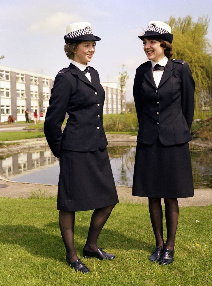 Two Greater Manchester Police officers strike a pose for the camera in one of a series of image intended to be used in a recruitment campaign in 1977. The location is the famous Bruche Police Training Centre near Warrington. Police officers from many local forces trained at the centre between 1946 and its closure in 2006. From the archives of our museum. www.gmpmuseum.co.uk
