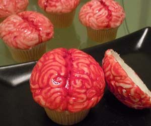 "Brain Cupcakes This link doesn't work---but you can get a chocolate ""brain"" mold on Amazon.  Use it for white chocolate ""brain"" topping on the cupcakes --tvg http://www.amazon.com/BRAIN-Miscellaneous-Candy-Mold-Chocolate/dp/B000EJRBHW/ref=pd_sxp_grid_pt_1_2/185-8188595-1265959"