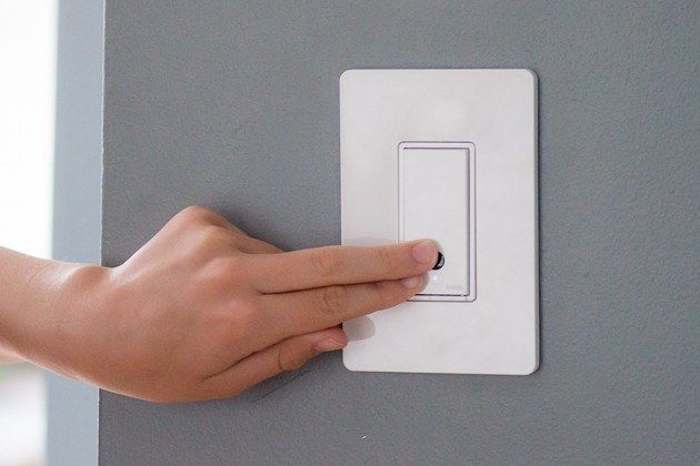 Two Fingers Pressing The Second Choice Pick For Dimmers It Is Mounted On A Grey Wall Light Switch Sconce Lighting Remote Control Light