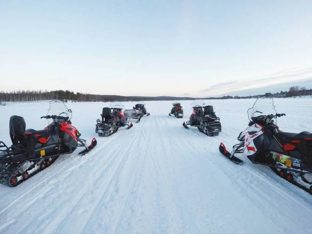 Snowmobiling over a frozen lake in Finland