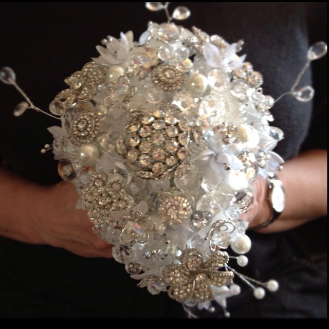 Sliver and clear buttons. Stunning sparkly beads, and gorgeous brooches make up this bouquet. Made by Devon Masters for the Button Room