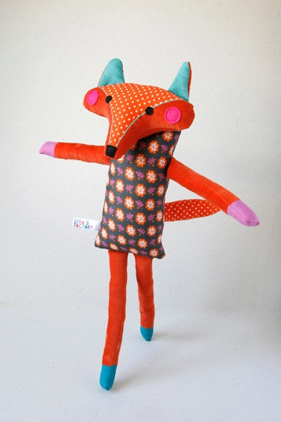 .beautiful vibrant fox plushie toy in vintage fabrics looks like its skipping towards spring,if he finds it hope he comes back and tells us where its gone,bbrrrrr!
