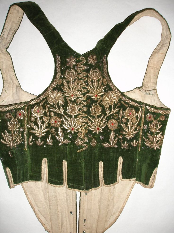 folk bodice from Bělá pod Bezdězem; silk, baleen, canvas, gold thread embroidery over cardboard, golden sequins, Bohemian garnets, golden trim, brass hook for hanging the skirts, bound in leather