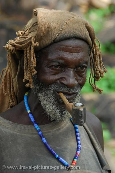 Africa | Dogon man with a traditional hat and pipe | © Willem Proos