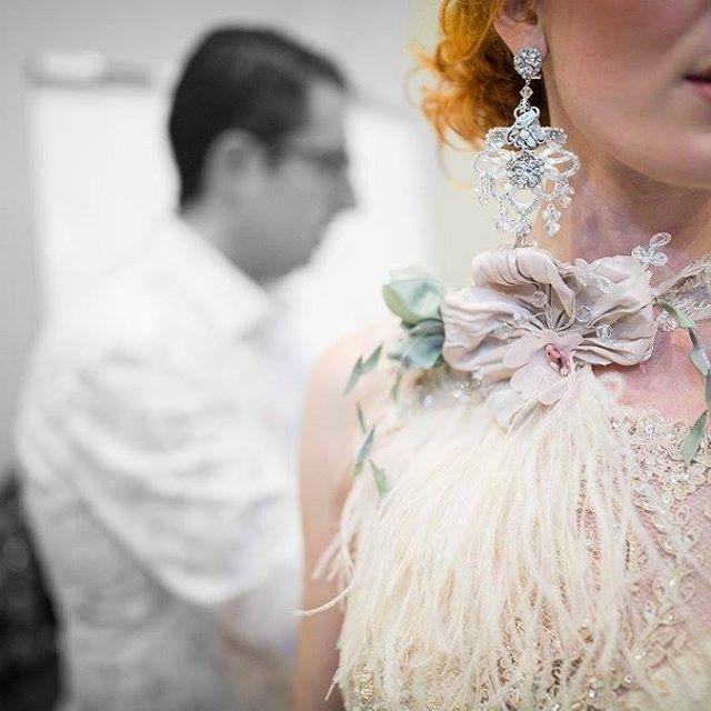 Focus on the detail of the unique cape by Anna Romysh ... So vintage! What do you think ??  #maltafashionweek #bridalshow #wdbvalletta #collection2017annaromysh #mfwa2016 #forbrides #vintagebridal #brides #bridetobe #wedinspiration #weddinginspiration #blushpink #feathers #gatsbystyle